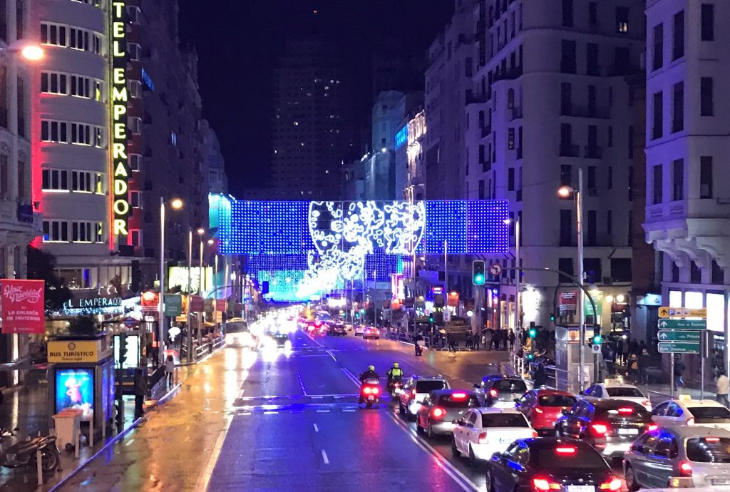 Madrid's Gran Via Street is lit up with Christmas lights on a cold December night.